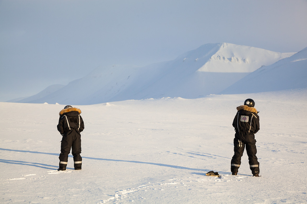UNIS students pee on Rabotbreen, Svalbard, on a class field trip by snowmobile to Tunabreen.