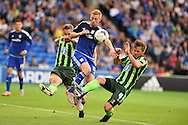 Eoin Doyle of Cardiff city © gets in between Paul Robinson (l) and Dannie Bulman of AFC Wimbledon. Capital One cup match, 1st round, Cardiff city v AFC Wimbledon at the Cardiff city stadium in Cardiff, South Wales on Tuesday 11th August  2015.<br /> pic by Andrew Orchard, Andrew Orchard sports photography.