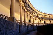 Detail of seating and architecture inside the bullring building at Ronda, Andalucia, Spain