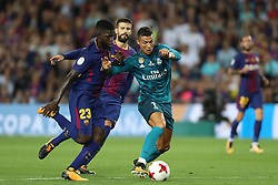 August 13, 2017 - Barcelona, Spain - Cristiano Ronaldo of Real Madrid duels for the ball with Samuel Umtiti of FC Barcelona during the Spanish Super Cup football match between FC Barcelona and Real Madrid on August 13, 2017 at Camp Nou stadium in Barcelona, Spain. (Credit Image: © Manuel Blondeau via ZUMA Wire)