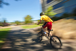 United States, Washington, Redmond, boy on bicycle on Sammamish River Trail (blurred motion)