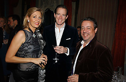 Left to right, NADJA SWAROVSKI, her husband RUPERT ADAMS and HAMISH MCALPINE at jeweller Stephen Webster's Christmas party held at Home House, 20 Portman Square, London W1 on 11th December 2006.<br /><br />NON EXCLUSIVE - WORLD RIGHTS