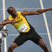 Athletics - Olympics: Day 9  Usain Bolt of Jamaica celebrates with his lightning bolt pose after winning the Men's 200m Final at the Olympic Stadium on August 18, 2016 in Rio de Janeiro, Brazil. (Photo by Tim Clayton/Corbis via Getty Images)