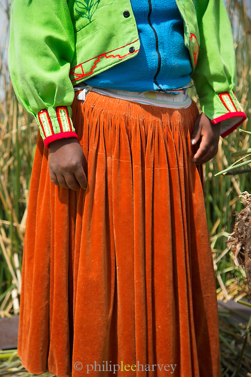 Detail of traditional dress worn by a native Uru woman on the Floating islands of Lake Titicaka, Puno, Peru, South America