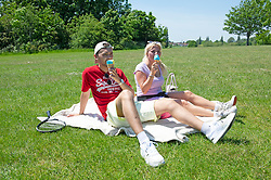 © Licensed to London News Pictures 01/06/2021. Bexley, UK. Two young people enjoying the heat wave weather at Danson Park in Bexley, South East London. Photo credit:Grant Falvey/LNP