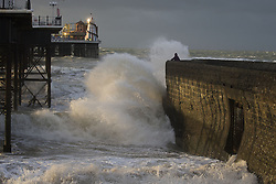 © Licensed to London News Pictures. 27/10/2013. BRIGHTON, UK Waves pound the sea defences. Waves at Brighton seafront this morning as Britain was braced for the worst storm for a decade today, which is set to bring driving rain and winds of up to 90mph to some areas. Photo credit : LNP