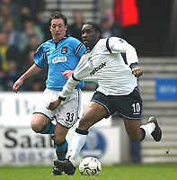 Photo Aidan Ellis.<br />Bolton Wanderers v Manchester City (FA Barclaycard Premiership) 05/04/2003.<br />Bolton's Jay Jay Okocha and City's Robbie Fowler