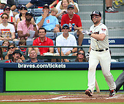 ATLANTA, GA - JULY 27:  Catcher Brian McCann #16 of the Atlanta Braves follows through on a swing during the game against the St. Louis Cardinals at Turner Field on July 27, 2013 in Atlanta, Georgia.  (Photo by Mike Zarrilli/Getty Images)