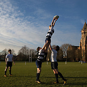 """Pupils take part in rugby practice on the playing fields of Rugby School in central England, January 20, 2015.  The public school, founded in 1567 was amongst the first """"Public"""" schools in England. The school is known as the home of rugby. Local legend  states that in 1823 pupil William Webb Ellis first ran with the ball inventing the game of rugby football which took its name from the school. In 2015 20 countries will compete in the Rugby World Cup which is hosted by England REUTERS/Neil Hall"""