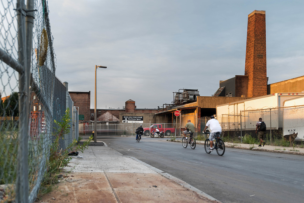 Taken Saturday, August 8th, 2015 from 7:25-7:46PM. Found and © by Mike Ritter.<br /> <br /> Norfolk Ave. intersects with Gerard St. in the distance and runs parallel to Mass Ave through an old industrial area of Roxbury. A city dump is just up Gerard St. on the left from this vantage point. There aren't many pedestrians or much traffic here. I was surprised to learn that the menacing guard dog who occasionally chased me along the fence of the junkyard as I biked by late at night between my South End studio and Dorchester home, was actually white faced and arthritic.