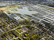 Nederland, Noord-Holland, Gemeente Langedijk, 16-04-2012; het Kanaal Alkmaar - Kolhorn scheidt bedrijventerrein Zandhorst (in de achtergrond) van landschapsreservaat Oosterdel. Dit gebied vormt een restant van het 'duizend eilandenrijk', voormalige veengronden ontstaan door ontwatering en afgraven van veen en in gebruik voor tuinbouw. Onderdeel van de Provinciale Ecologische Hoofdstructuur (EHS). De eilanden in de voorgrond hoorden ook bij het tuinbouwgebied zijn nu bebouwd..Landscape reserve Oosterdel (NW Netherlands) . This area is a remnant of thousand islands, former peatlands caused by drainage and excavation of peat and is used horticulturally. Part of the Provincial  Ecological Structure  (EHS).  luchtfoto (toeslag), aerial photo (additional fee required);.copyright foto/photo Siebe Swart