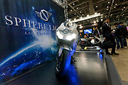A motorbike with a reflective wrap on the  Sphere light stand at the 44th annual Tokyo Motorcycle show. Tokyo Big Sight exhibition hall, Odaiba, Tokyo, Japan. Friday March 24th 2017. The show runs from Friday March 24th to Sunday March 26th and showcases technological innovations from all the main motorcycle manufacturers along with companies providing protective helmets pads and  clothing to decoration and even camping gear for bike-touring..