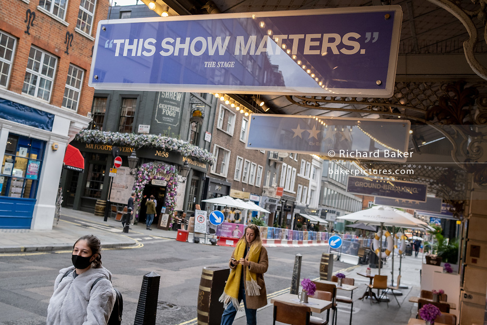 Theatre reviews fo ther 'Dear Evan Hansen' musical hang outside the Noel Coward Theatre on St. Martin's Lane in the heart of the capital's West End Theatreland, still closed to audiences during the Coronavirus pandemic, on 29th September 2020, in London, Westminster, England. Despite the government's £1.15bn financial rescue package for the Arts industry and cultural organisations in England , made up of £880m in grants and £270m of repayable loans, London's theatre industry has been hit hard by the pandemic, being closed since the March lockdown closures which has affected 137,250 Arts industry jobs, worth £21.2bn in direct turnover.