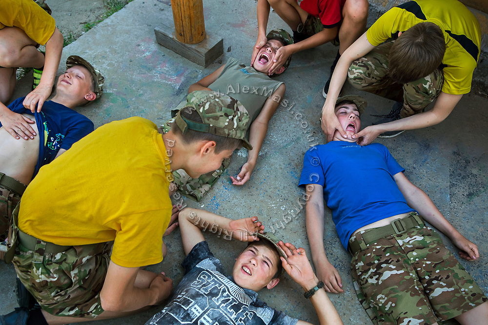 Youngsters participating to the ultra-nationalistic Azovets children's camp are learning about combat wounds and rapid first-aid response on the battlefield, during training on the banks of the Dnieper river in Kiev, Ukraine's capital.