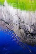Cliff reflected in the Merced River, Yosemite National Park, California USA
