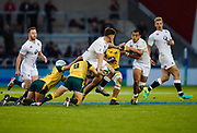 England centre  Johnny Williams looks to offload the ball to centre Joe Marchant during the World Rugby U20 Championship  match England U20 -V- Australia U20 at The AJ Bell Stadium, Salford, Greater Manchester, England on June  15  2016, (Steve Flynn/Image of Sport)