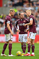 Stephen Kingsley, Barrie McKay and Alex Cochrane (#17) of Heart of Midlothian FC discuss a free kick during the Cinch SPFL Premiership match between Heart of Midlothian and Hibernian at Tynecastle Park, Edinburgh, Scotland on 12 September 2021.