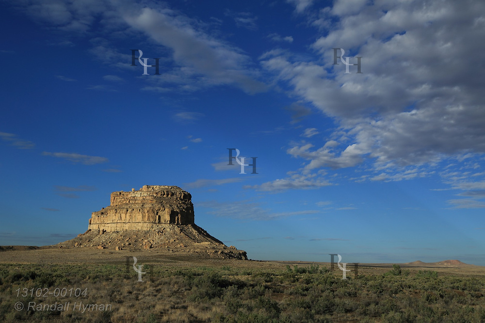 Early morning light and clouds showcase Fajada Butte in late July at Chaco Culture National Historical Park, New Mexico.