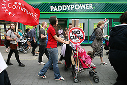Newham, London. 05/07/2014<br /> Newham residents protest council cuts and relocation of council tenants outside of London. The Focus E15 Mothers campaign is a group of young single mothers who were placed into temporary accommodation by Newham council, after being evicted from council housing, but were warned they could be re-housed as far away as Birmingham, Manchester and Hastings. Some mothers have already relocated outside of London due to the lack of affordable social housing.<br /> Photo: Anna Branthwaite/LNP