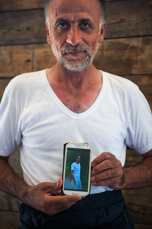 50 year old Mamum from Damascus showing me a picture of his son who lives in Germany. He hopes that he will reunite soon with him.