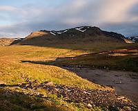 River flows through the scenic Syterskalet mountain valley near Viterskals hut, Kungsleden trail, Lapland, Sweden