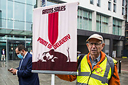 A Quaker holds a banner during a Stop The Arms Fair protest outside ExCeL London on the first day of the DSEI 2021 arms fair on 14th September 2021 in London, United Kingdom. Activists from a range of different groups have been protesting outside the venue for one of the worlds largest arms fairs for over a week.