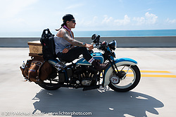 Jody Perewitz riding her 1936 Harley-Davidson through the Keys in the final leg of the Cross Country Chase motorcycle endurance run from Sault Sainte Marie, MI to Key West, FL. (for vintage bikes from 1930-1948). Stage-10 covered 110 miles from Miami to the finish in Key West, FL USA. Sunday, September 15, 2019. Photography ©2019 Michael Lichter.