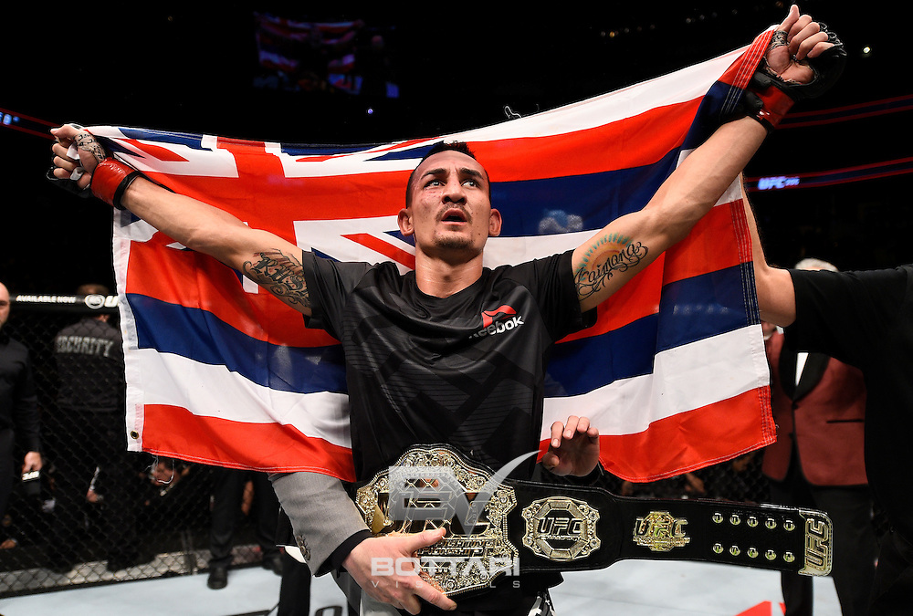 TORONTO, CANADA - DECEMBER 10:  Max Holloway celebrates his TKO victory over Anthony Pettis in their interim UFC featherweight championship bout during the UFC 206 event inside the Air Canada Centre on December 10, 2016 in Toronto, Ontario, Canada. (Photo by Jeff Bottari/Zuffa LLC/Zuffa LLC via Getty Images)