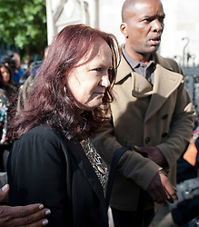 © London News Pictures. 16/09/2013 . London, UK.   PAMELA DUGGAN, mother of Mark Duggan arriving at the Royal Courts of Justice in London where an inquest in to the death of her son is due to start today. Mark Duggan was shot by police in an incident which sparked rioting across England in 2011. Photo credit : Ben Cawthra/LNP