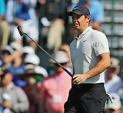 April 6, 2018 - Augusta, GA, USA - Rory Mcllroy reacts to missing a putt on the first hole during the second round of the Masters at Augusta National Golf Club on Friday, April 6, 2018, in Augusta, Ga. (Credit Image: © Jason Getz/TNS via ZUMA Wire)
