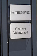 Two signs indicating the offices of Etablissement Thunevin and Chateau Valandraud in the Saint Emilion village main street  Saint Emilion Village  Bordeaux Gironde Aquitaine France