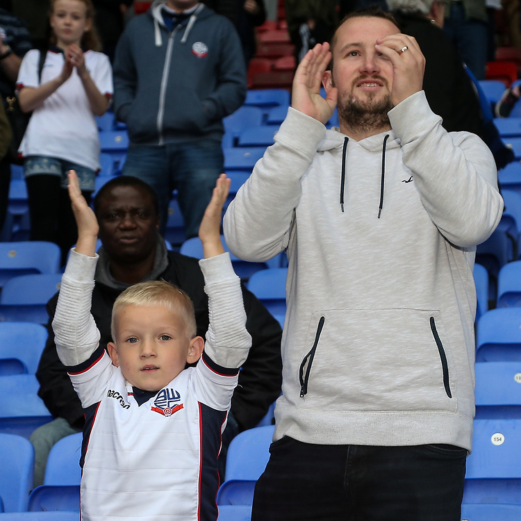 Bolton Wanderers' supporters celebrate their side's 2-1 victory against Sheffield Wednesday<br /> <br /> Photographer Andrew Kearns/CameraSport<br /> <br /> The EFL Sky Bet Championship - Bolton Wanderers v Sheffield Wednesday - Saturday 14th October 2017 - Macron Stadium - Bolton<br /> <br /> World Copyright © 2017 CameraSport. All rights reserved. 43 Linden Ave. Countesthorpe. Leicester. England. LE8 5PG - Tel: +44 (0) 116 277 4147 - admin@camerasport.com - www.camerasport.com