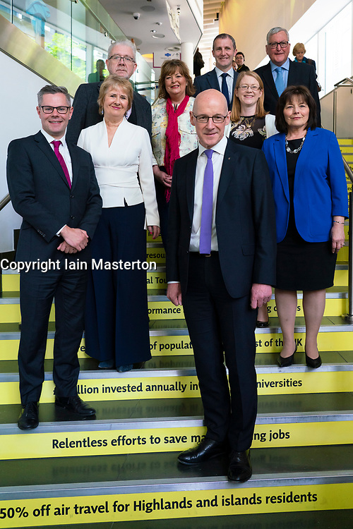 Edinburgh, Scotland, UK. 28 April, 2019. Day 2 of thee SNP ( Scottish National Party) Spring Conference takes place at the EICC ( Edinburgh International Conference Centre) in Edinburgh. Pictured; SNP Government Cabinet Ministers group photo on stairs of the EICC . John Swinney to front right.
