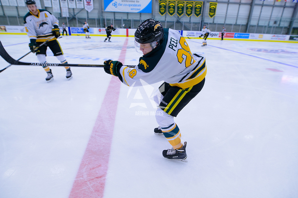 2nd year defence man Landon Peel (28) of the Regina Cougars in action during the Men's Hockey Home Opener on October 21 at Co-operators arena. Credit: Arthur Ward/Arthur Images
