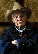 """Retired Parker Ranch manager and cowboy, Jamie Dowsett, 85, who spent most of his life on horses and has rich stories to tell, is photographed wearing his favorite cowboy hat at his home in Waimea, Hi.  """"I'm 85 years old and I still think that cows and horses are the best things that ever walked on earth.  I would give anything if I could still be a cowboy...being out there on the land where nobody bothers you, out in the open where it's quiet...the horses are giving you a wonderful ride in the beautiful countryside...that is a feeling not many people have the opportunity to experience,"""" says Dowsett wistfully."""