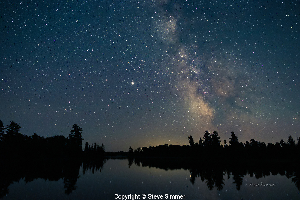 Looking south over Bearhead Lake, the Milky Way center rises alongside Jupiter and Saturn.