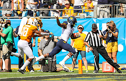 Sep 1, 2018; Charlotte, NC, USA; West Virginia Mountaineers wide receiver T.J. Simmons (1) catches a pass and runs for a touchdown during the first quarter against the Tennessee Volunteers at Bank of America Stadium. Mandatory Credit: Ben Queen-USA TODAY Sports
