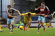 Leon Best of Rotherham United (c) tries to hold off James Tarkowski and Matthew Lowton of Burnley.Skybet football league Championship match, Burnley v Rotherham United at Turf Moor in Burnley, Lancs on Saturday 20th February 2016.<br /> pic by Chris Stading, Andrew Orchard sports photography.