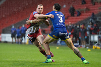 Rugby League - 2020 Coral Challenge Cup - Salford Red Devils vs Warrington Wolves - TW Stadium, St Helen's<br /> <br /> Salford Red Devils's Dan Sarginson is tackled by Warrington Wolves's Anthony Gelling<br /> <br /> COLORSPORT/TERRY DONNELLY