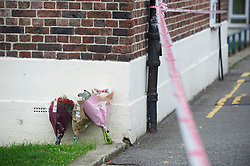 © Licensed to London News Pictures. 06/11/2018. Tulse Hill, UK.Flowers at the scene. Police guard a cordon in Tulse Hill as a murder investigation is launched after a 16 year old boy was found with fatal injuries last night.  Photo credit: Grant Falvey/LNP
