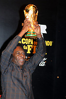 20100206: RIO DE JANEIRO BRAZIL - Brazilian football star Pele holds FIFA trophy. The World Cup Trophy has arrived to Forte De Copacabana in Rio, Brazil<br />