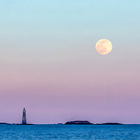 Snow full moon rising behind the I love you light aka Minot's Ledge Light and officially called Minots Ledge Lighthouse. This iconic Massachusetts lighthouse is located offshore of Cohasset and Scituate, MA. Photograph taking from Sandy Beach in the town of Cohasset.<br /> <br /> The I love you lighthouse photography images are available as museum quality photography prints, canvas prints, acrylic prints, wood prints or metal prints. Fine art prints may be framed and matted to the individual liking and decorating needs:<br /> <br /> https://juergen-roth.pixels.com/featured/the-i-love-you-lighthouse-juergen-roth.html<br /> <br /> Good light and happy photo making!<br /> <br /> My best,<br /> <br /> Juergen