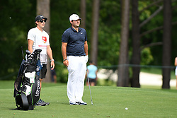 May 3, 2019 - Charlotte, NC, U.S. - CHARLOTTE, NC - MAY 03: Patrick Reed and his caddie talk about their approach on the 11th green in round two of the Wells Fargo Championship on May 03, 2019 at Quail Hollow Club in Charlotte,NC. (Photo by Dannie Walls/Icon Sportswire) (Credit Image: © Dannie Walls/Icon SMI via ZUMA Press)