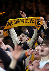 Wolverhampton Wanderers fans in the stand celebrate after the final whistle during the FA Cup quarter final match at Molineux, Wolverhampton.