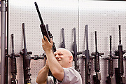 15 MAY 2009 -- PHOENIX, AZ: Andy Clark, (CQ) from Mesa, looks at some of the scopes available for rifles in the Trijicon booth Friday. More than 60,000 people are expected to attend the NRA convention and annual meeting, which is being held at the Phoenix Convention Center through Sunday. This is the 138th annual meeting of the National Rifle Association. Photo by Jack Kurtz