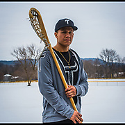 """Hiana Thompson on the Onondaga Reservation. Hiana plays professionally for the National Lacrosse League with the Georgia Swarm. """"My son is always runnin' around the house with his stick. We make sure we pass it on to them as soon as we can, that way they will carry the tradition to the next generation."""""""