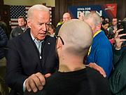 """04 DECEMBER 2019 - AMES, IOWA: Former Vice President JOE BIDEN talks to individual Iowans on the rope line after his campaign event in Ames Wednesday. Vice President Biden is touring Iowa this week on his """"No Malarkey"""" bus tour. He spoke at Iowa State University Wednesday. Iowa hosts the first presidential selection event of the 2020 election cycle. The Iowa caucuses are on February 3, 2020.        PHOTO BY JACK KURTZ"""