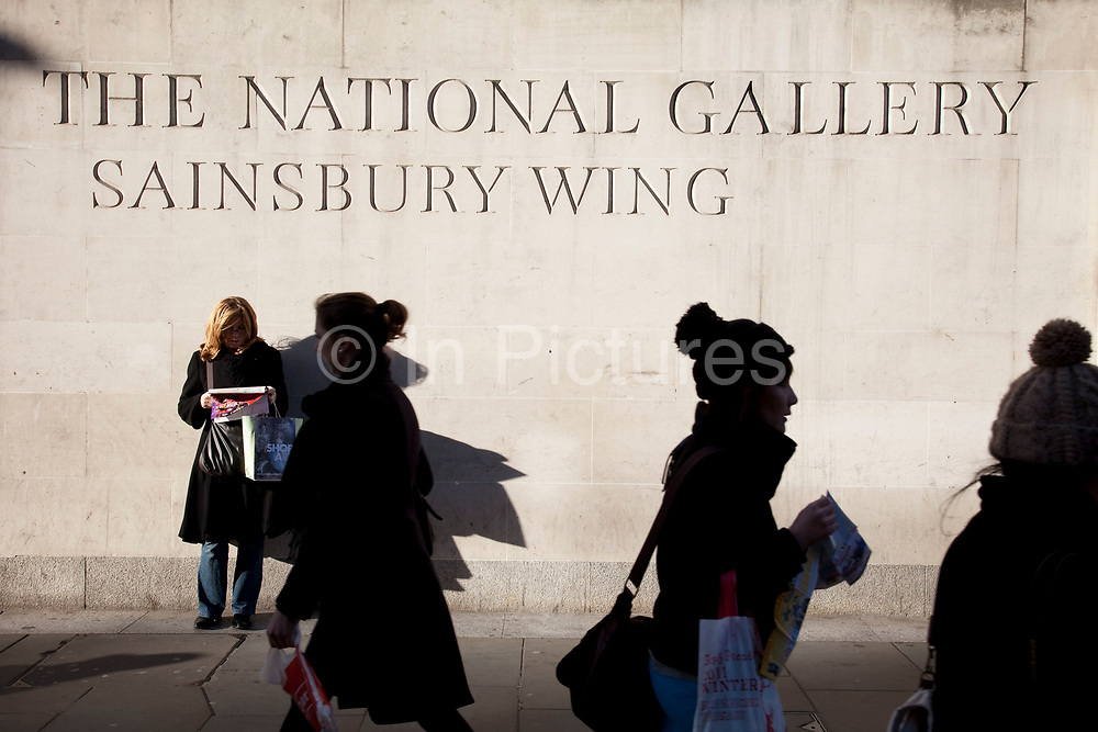 People walk by the Sainsbury Wing of The National Gallery, London. The most important addition to the building in recent years has been the Sainsbury Wing, designed by the postmodernist architects Robert Venturi and Denise Scott Brown to house the collection of Renaissance paintings, and built in 1991.