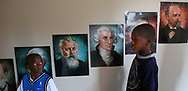 East Elementary students Jamal Jackson, left, and Nasim Wailly, pass by portraits of musical composer greats, Johannes Brahms,left, Joseph Haydn, and Antonin Dvorak as they make their way from the 3rd floor P.E. Room (there is no gymnasium) to the outside play area. Not having a gymnasium hinders many activities especially when weather conditions(cold, rainy, extremely hot, etc.) don't allow for use of the outside play area.