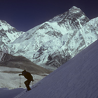 Mountaineer Jay Jensen skis on the Changri Nup Glacier near Mount Everest, which towers in the background.